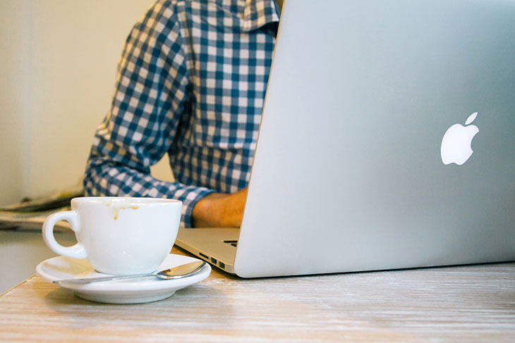 man with his laptop and coffee