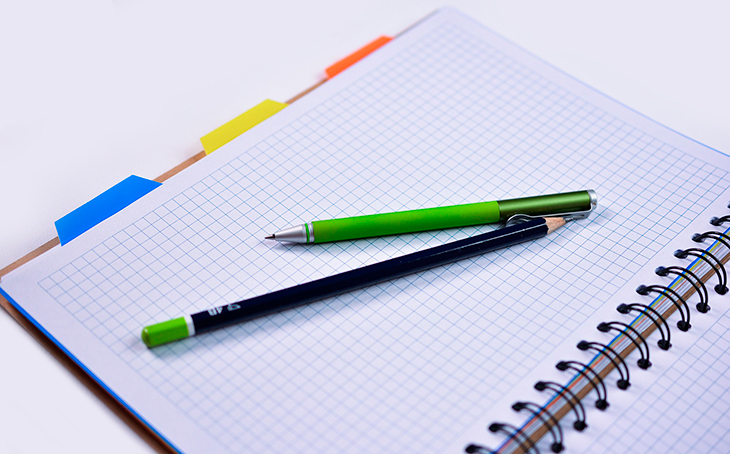 graph paper notebook and pencils